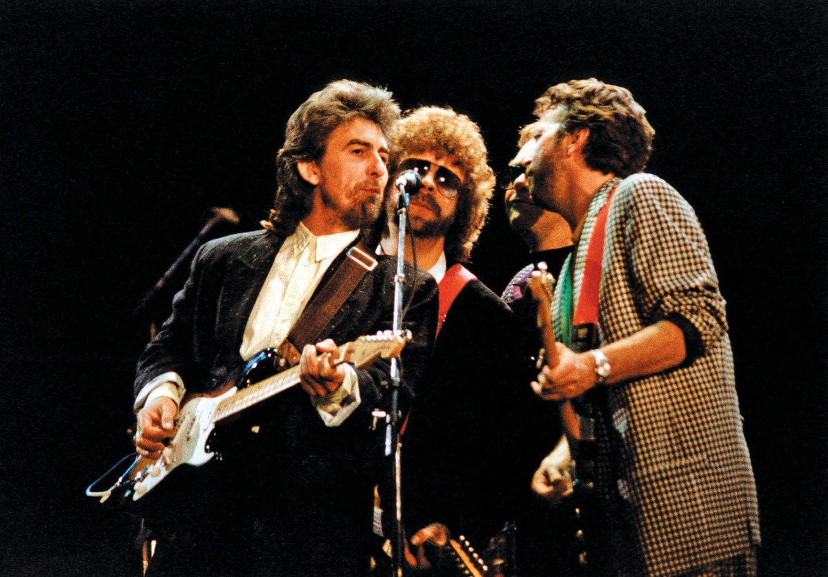 George Harrison Eric Clapton And Ring Starr Play While My Guitar Gently Weeps In 1987